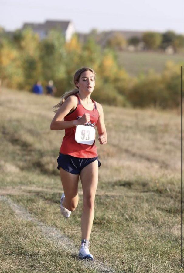 Julia Mclain sprints towards the finish for her first win as a varsity runner. Photo courtesy of PrepRunningNerd.