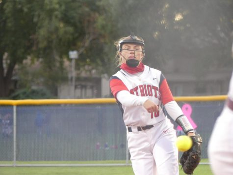 Senior Jackie Morrissey pitches in the Swing for the Cure game against Papillion La-Vista. Photo by Lydia Bruckner.