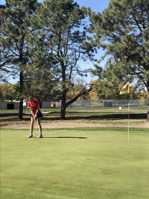 Ella Haakinson putts on the 18th holf of the State Golf course in Norfolk. Photo by Coach Geary.