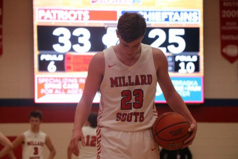 Senior Michael Harding prepares for a free throw in the game against Bellevue West. Photo by Caden Blair.