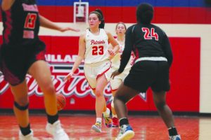 Sophomore Mya Babbitt drives down the court with the ball in the game against Lincoln High. Photo by Haley Dougherty.