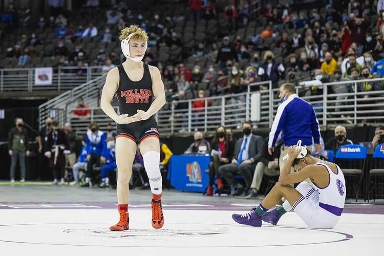 Senior Caleb Coyle celebrates his win in the 2021 State Wrestling Class A Finals, winning over long time competitor, Gabe Rice. Photo courtesy of Caleb Coyle.