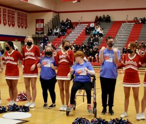Senior Carly Barkus cheers with her friends during a Unified Cheer performance. Photo courtesy of @MSHSactivities.
