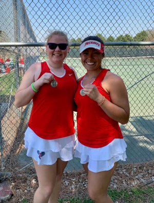 Junior Callie Freeman and her former doubles partner, Damaris Cuevas, celebrate their first place win at the Bellevue West Invite during her freshman year. Photo courtest of @MSPatriotTennis