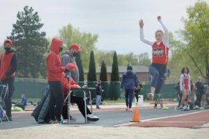 Junior Lilee Kaash jumps off the board at the Lincoln High Invite.
