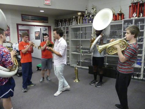 """From left to right, Elijah Daffer, Ethan Wilson, James Minor, Sebastian Matos, Jerome Woolridge, and Alex Gruhn practice playing """"Go Big Red"""". This is the first song they have learned on their new instruments. Photo by Vivian Kaldahl"""